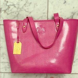 Pink embossed vegan leather tote bag.